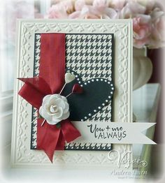 Love the colours; unique & elegant with black & white checked back ground, blacked pearled heart with wide red ribbon
