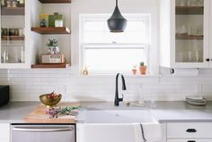 A Century-Old Home in New Jersey   A Cup of Jo:  Pendant: Tom Dixon. I like the upper cabinets and the shelf by the window