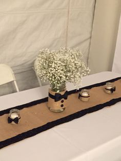 Burlap and Black Lace Runners. Center pieces are Mason Jars with black bow tie look and baby's breath! Candles are Gerber jars.