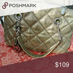 Quilted Michael Kors Authentic Michael Kors quilted bag medium size. Beautiful shimmer gold tan color with silver MK charm. Michael Kors Bags Shoulder Bags