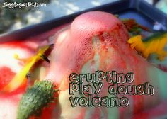 Erupting Play Dough Volcano- Super fun way of bringing science into the home. This is a much easier way of making an erupting volcano than the paper-mache way.  Kids will have lots of fun watching their volcano erupt. #jugglingwithkids #volcano #erupt #bakingsoda #vinegar