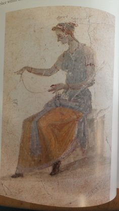"Robert's ""Life & Death in Pompeii & Herculeneum"" - pg 78. Pompeii fresco. Woman spinning, wearing white/natural tunica (artist has outlined the sleeves in red for visibility), sea green stola, saffron stola with pale blue edging wrapped around her waist (?). Bracelets and brown leather shoes."