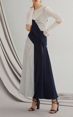 This **Adeam** asymmetrical draped dress features a v-neckline with a pattern combination between stripes and solid.