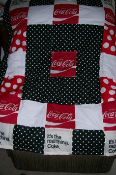 This quilt was made by a lady at the greenville womens facility. Love the coca-cola fabric