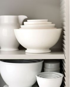 "Martha considered every corner of her kitchen in Bedford, New York, right down to the shelving supports. ""I like 'bird's beak' supports, an old carpentry style with notches that let shelves slide in and out,"" Martha says. No holes, no hardware -- the look is streamlined. Martha Stewart Collection Whiteware large pitcher, macys.com."