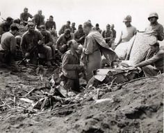 Christ on the battlefield: the priest as warrior. A Catholic priest gives Holy Communion to soldiers on Iwo Jima.