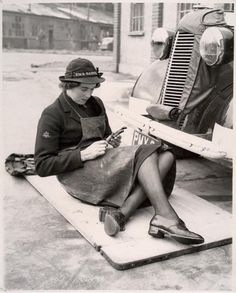 Women's Royal Naval Service mechanic, connected to the H.M.S. Daedalus A 'Wren' - a woman from the Women's Royal Naval Service - works as a mechanic, c. 1939 - 1945. Her hat appears to read 'H.M.S. Daedalus'.