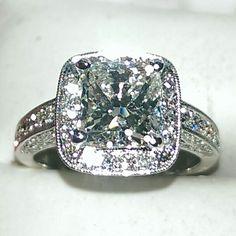 3.23 carat diamond engagement ring set in 18K white gold