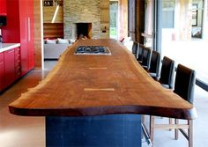 This kitchen features an18-foot long counter made from a slab of #reclaimed #wood. Walnut. What a find.