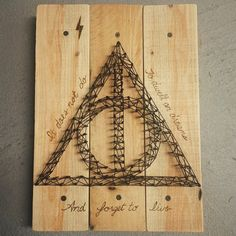 """""""It does not do to dwell on dreams and forget to live."""" Helped @nikki_craft with her #HarryPotter themed string art! She did most the work!  #stringart #pallet #wood #HarryPotter #nerdy"""