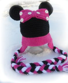 Such a fun and girly hat, featuring braids and a giant bow with Minnie Mouse Ears. Colors can be changed, or a slightly different version made for boy for a Mickey Hat.