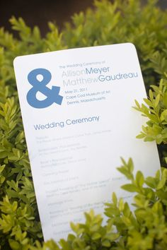 simple wedding program w/ emblem in place of & sign