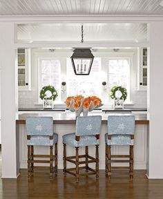 Inspiration: Boxed island with flat counter top...yes! And, love those  blue upholstered stools.