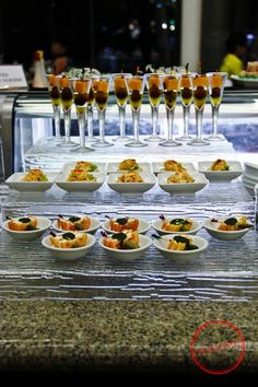 Tomato feta cheese, smoked salmon terine, and marinated cheese with peppercorn from Acaci..