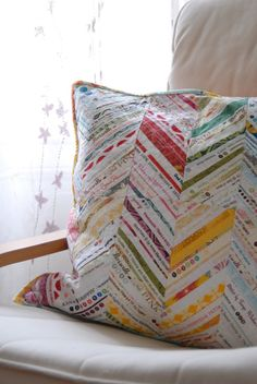 This Chevron pillow made w/ fabric selvage adds a splash of color to the room. Think about doing a #crochet project like this. Variegated yarn maybe?
