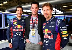 Keanu Reeves Photos Photos - Actor Keanu Reeves poses with Sebastian Vettel of Germany and Infiniti Red Bull Racing and Daniel Ricciardo of Australia and Infiniti Red Bull Racing in the team garage after final practice for the United States Formula One Grand Prix at Circuit of The Americas on November 1, 2014 in Austin, United States. - F1 Grand Prix of USA - Qualifying