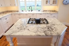 Super White Granite (aka Fantasy White Granite) by Granite Grannies (granitegrannies.com) #kitchen #granite