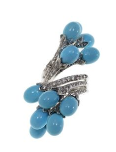 Editor's Picks from the Elizabeth Taylor Auction | Arab Women Now. A light blue hard stone, diamond and simulated colorless gemstone ring with a blue gemstone set in 18k gold.