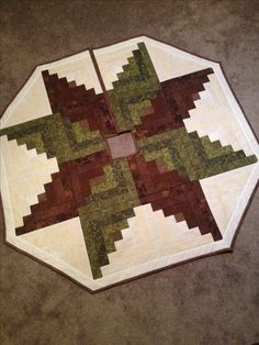 My own take on the log cabin tree skirt I saw. Used a 'quilt as you go' method.