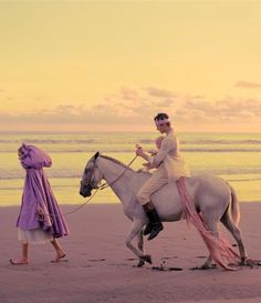 Little purple riding hood.  I love how there is a baby he's holding on the horse :)