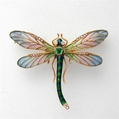 AN ART NOUVEAU EMERALD ENAMEL AND DIAMOND DRAGONFLY BROOCH