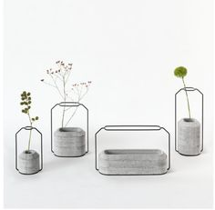 These concrete + metal vases are the most beautiful.