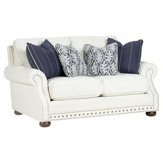 Rolled-arm loveseat with wood framing and nailhead-trimmed upholstery. Product: LoveseatConstruction Material: Wood, fabri...