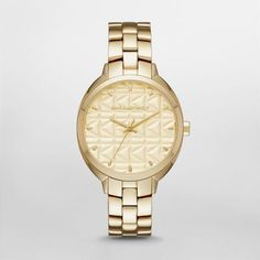 Kuilted Gold-Tone Three-Hand Watch A signature K-kuilting etched dial adds a kool, modern edge to the KARL LAGERFELD Kuilted watch, new for fall 2016. A polished gold-tone case and three-link bracelet complete the look.