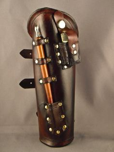 Steampunk leather bracer - Scribe - (something like this would be great for a practicing witch, to have a wand and crystals handy at all times.)