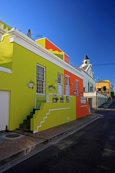 'Painted in vivid colours straight out of a packet of liquorice allsorts, the jumble of crumbling and restored heritage houses and mosques along the cobblestoned streets of the Bo-Kaap are visually captivating. Colourful Buildings, Colorful Houses, South Afrika, Cape Town South Africa, Port Elizabeth, Kenya, Most Beautiful Cities, Africa Travel, House Colors