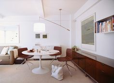 One of Goolrick's custom lights cantilevers over a marble-topped Saarinen Tulip table with the slight camber of a laden fishing pole. Mesa Tulip, Saarinen Table, Dining Room Storage, Tulip Table, Compact Living, Contemporary Interior, Small Spaces, Living Spaces, Living Room