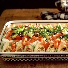 Healthy Chicken Enchiladas, made even healthier by swapping sour cream for Greek yogurt!