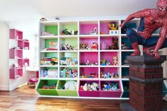 Charming Kids Play Room Ideas: White Attic Stule Childsroom With Pink And Green Storage Cubes And Spiderman ~ homedesignlovers.com Kids Bedroom Inspiration