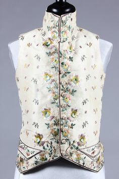 Vest, c. 1790-1800. Cream eau de nil silk embroidered in floss silks in shades of mauve, green and pink, dandelion clock sprigs, line back panels.