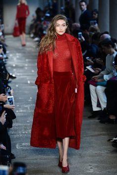 Gigi Hadid Photos Photos - Model Gigi Hadid presents a creation for fashion house Max Mara during the Women's Fall/Winter 2017/2018 fashion week in Milan, on February 23, 2017.  / AFP / Miguel MEDINA - Max Mara - Runway - Milan Fashion Week Fall/Winter 2017/18