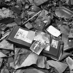 Not originally published in LIFE. A photo album, pieces of pottery, a pair of scissors — shards of life strewn on the ground in Nagasaki, 1945.