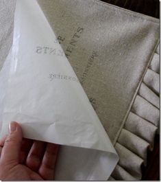 Print on wax paper and iron onto fabric... will have to try this!