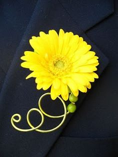 Gerbera Daisies and Mini-Gerbera Daisies add a festive touch. This is a fun idea for a simple boutonniere with a pop of color.