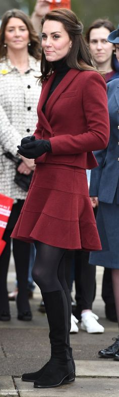 Feb 22-17 The Duchess of Cambridge traveled to Wales to visit two Action for Children projects supporting vulnerable families, wearing her chic burgundy Paule Ka suit. Kate teamed the suit with her Stuart Weitzman Half N Half boots, her Kiki McDonough Eternal Citrine Cushion & Diamond Earrings.