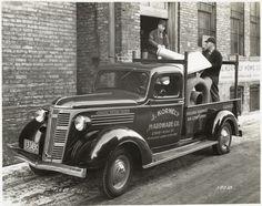 Model T 14 B – F 21 Men are loading hardware.!