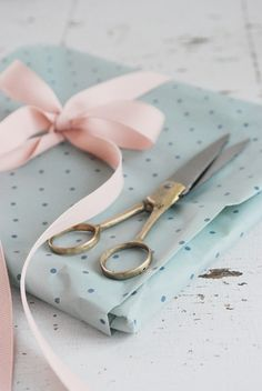 Pale blue gift wrap and pink ribbon
