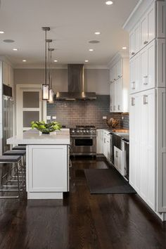 White, gray and wood. Mixed materials in the kitchen. I love how the white and grey keep it clean and the dark wood flooring adds warmth.