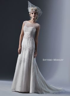 Seductive illusion neckline and back, adorned with opalescent pearls and sequins. Easton by Sottero and Midgley.