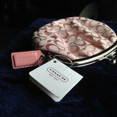 Coach NWT change purse. Brand New Pretty in Pink and just adorable. Great size. Sorry, no trades. Coach Bags Clutches & Wristlets