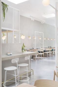 Biasol: | no19. Beautiful pale interior scheme with a soft green, pale wood furniture and white with contemporary wall lighting