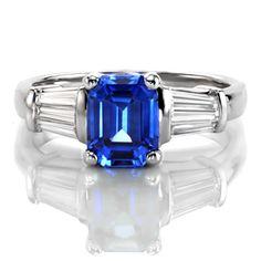 Design 2270 from Knox Jewelers features a 2.00ct Emerald cut blue sapphire center stone with baguette cut diamonds to either side.