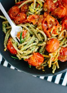 Delicious summertime pasta dish with pesto, squash noodles and spaghetti with burst cherry tomatoes - cookieandkate.com