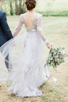 Grey Wedding dress with low back (Wedding dress + headpiece: Lady Evelyn) - Luxurious Olive and Grey Wedding Ideas by Irena Kabelis (Photography) + A beautiful way run by Belle & Beau Fine Art Photography & Naomi Kenton Photography (Workshop) - via Magnolia Rouge