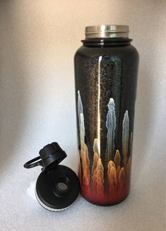 A personal favorite from my Etsy shop https://www.etsy.com/listing/527602972/red-black-and-white-40oz-stainless-steel