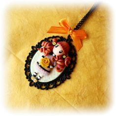 Polymer clay, necklace with cameo with doll Gorjouss. Follow me on Facebook : www.facebook.com/BijouxdiPatty